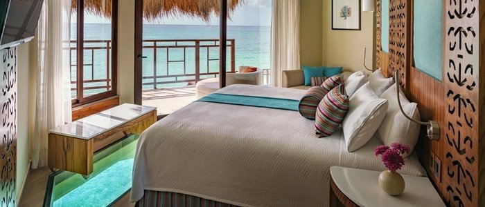 El Dorado Maroma includes luxurious over the water bungalows