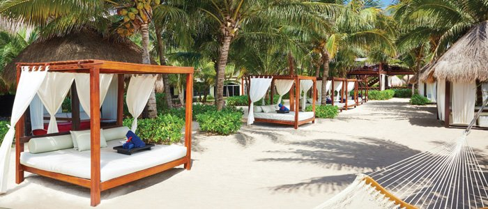 Come lounge at the beach at El Dorado Royale