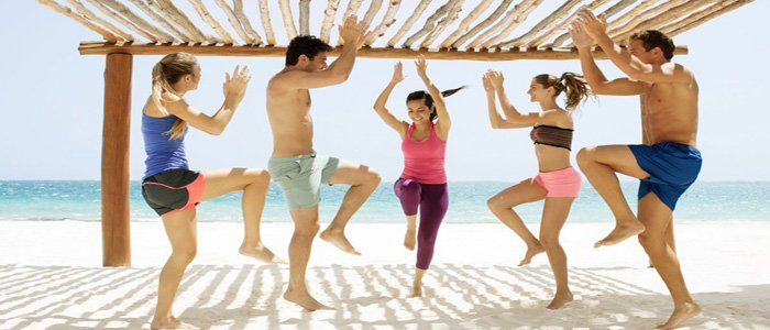 Beach yoga at Excellence Riviera Cancun