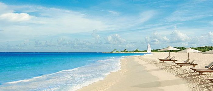 Secrets Maroma includes white sandy beaches and blue waters