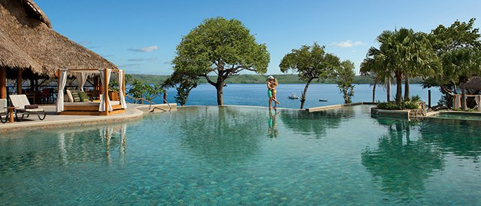 Secrets Papagayo Costa Rica includes stunning ocean views and poolside service for your honeymoon