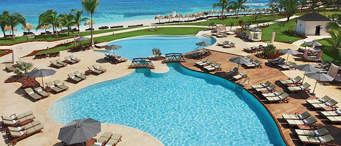 Secrets St James includes beautiful pools with views of the ocean