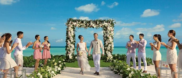 Secrets Cap Cana include beach weddings