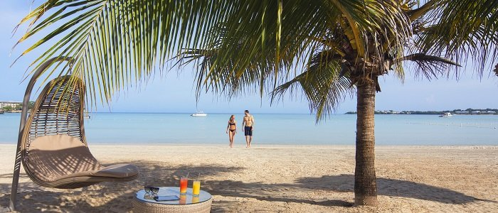 Hideaway Royalton Negril includes white sandy beaches and blue waters